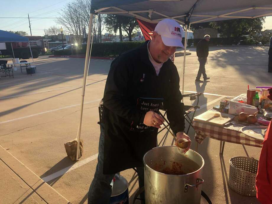 Rick Ellis serves up chili at the Katy Area Chamber of Commerce booth at the Katy ISD FFA Chili Cook-off on Thursday, Feb. 6, at 814 East Ave. Photo: Tracy Maness / Staff Photo