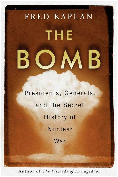 "This cover image released by Simon & Schuster shows ""The Bomb: Presidents, Generals and the Secret History of Nuclear War"" by Fred Kaplan. (Simon & Schuster via AP)"