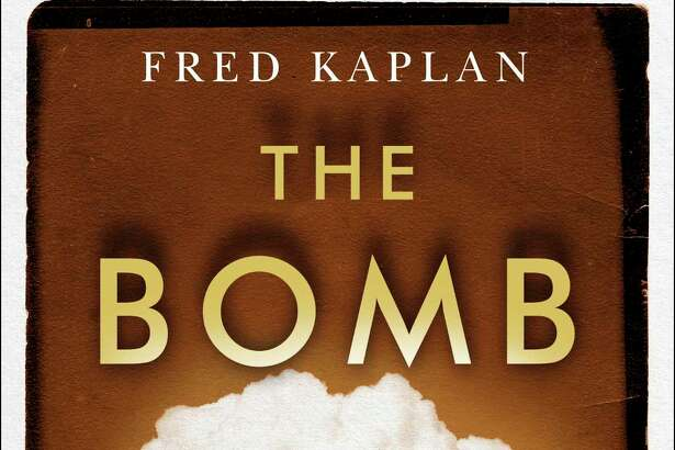 """This cover image released by Simon & Schuster shows """"The Bomb: Presidents, Generals and the Secret History of Nuclear War"""" by Fred Kaplan. (Simon & Schuster via AP)"""