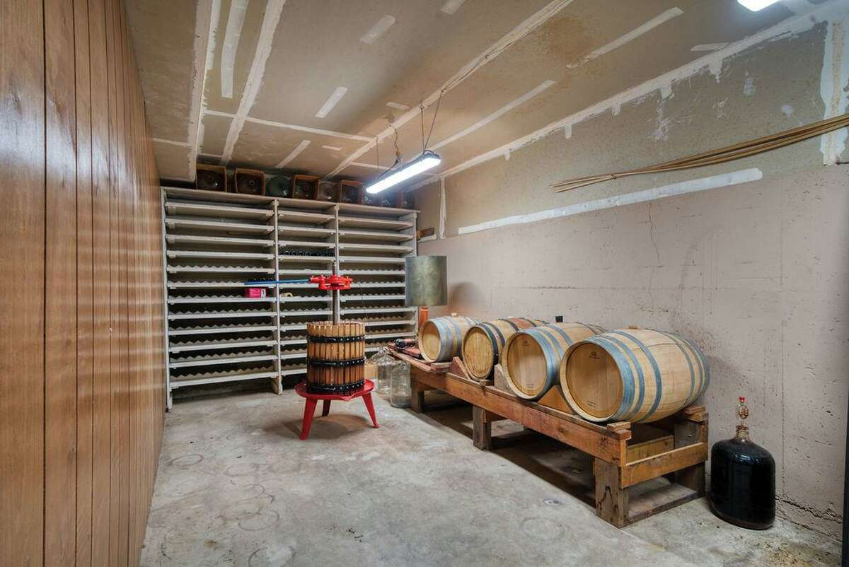 The four-bedroom home at 3460 Mount Veeder Road in Napa includes a winemaking and storage room.