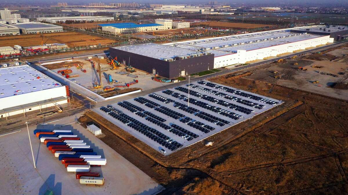 SHANGHAI, CHINA - DECEMBER 07: Aerial view of new Model 3 electric vehicles sitting parked at the Tesla Inc. Gigafactory on December 7, 2019 in Shanghai, China. (Photo by VCG/VCG via Getty Images)
