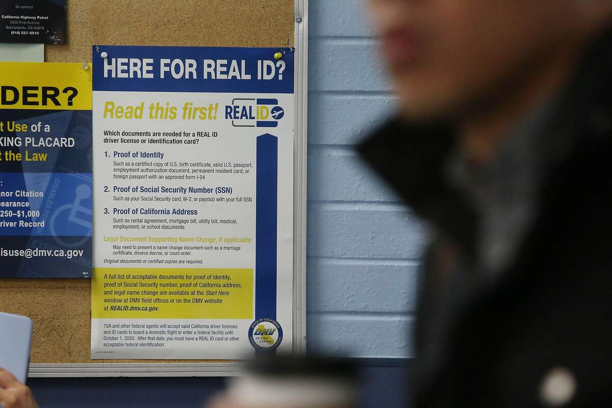 A poster for the Real ID is seen on a cork board with other notices at the DMV on Fell Street on Friday, January 24, 2020 in San Francisco, Calif.