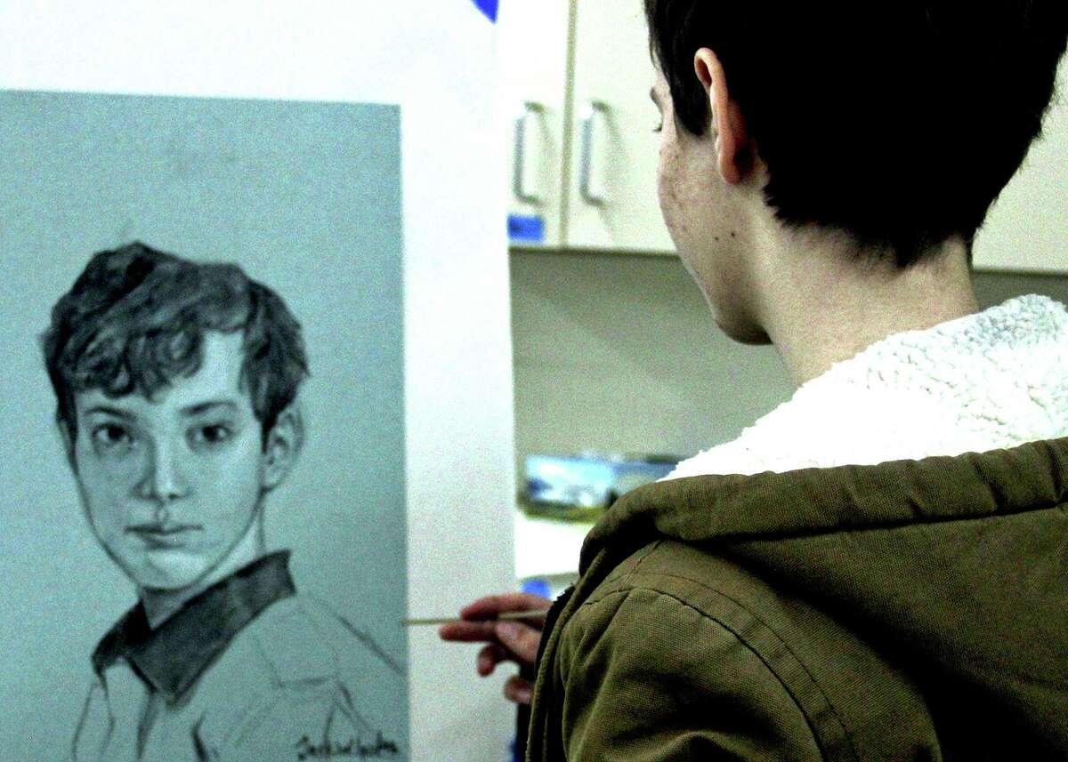 A Madison Daniel Hand High School art student works on his self-portrait.