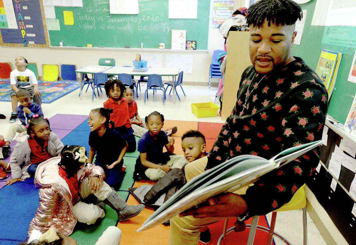 Quarde Alfred, a first year teacher at Homer Drive Elementary, works with his kindergartners. Alfred was a janitor working for BISD when a principal took note of his interaction with students and suggested he pursue teaching. After taking classes at Region V, Alfred earned his certification and says his life has been transformed as he moves in this new life and career path. Photo taken Tuesday, Jan. 21, 2020 Kim Brent/The Enterprise