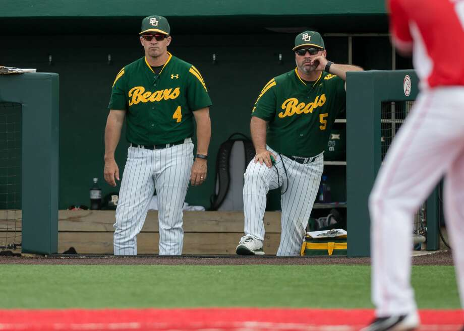 HOUSTON, TX - JUNE 03: Baylor Bears assistant coach Jon Strauss (4) and Baylor Bears head coach Steve Rodriguez (5) watch as the Houston Cougars score a run during the Houston Regional baseball game between the Baylor Bears and Houston Cougars on June 3, 2017 at Schroeder Park in Houston, Texas. (Photo by Leslie Plaza Johnson/Icon Sportswire via Getty Images) Photo: Icon Sportswire/Icon Sportswire Via Getty Images