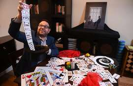 Robert Strong, The Comedy Magician, rehearses tricks at his Palo Alto home on Friday February 7, 2020. Strong recently established an LLC to avoid employment restrictions on his performances.