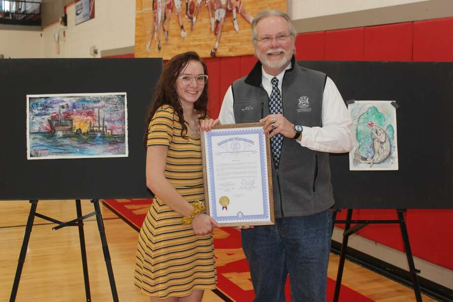 State Rep. Jack O'Malley honors Benzie Central senior Emma Quick as one of two winners of the Pure Michigan Art Competition sponsored by his office. Photo: Robert Myers