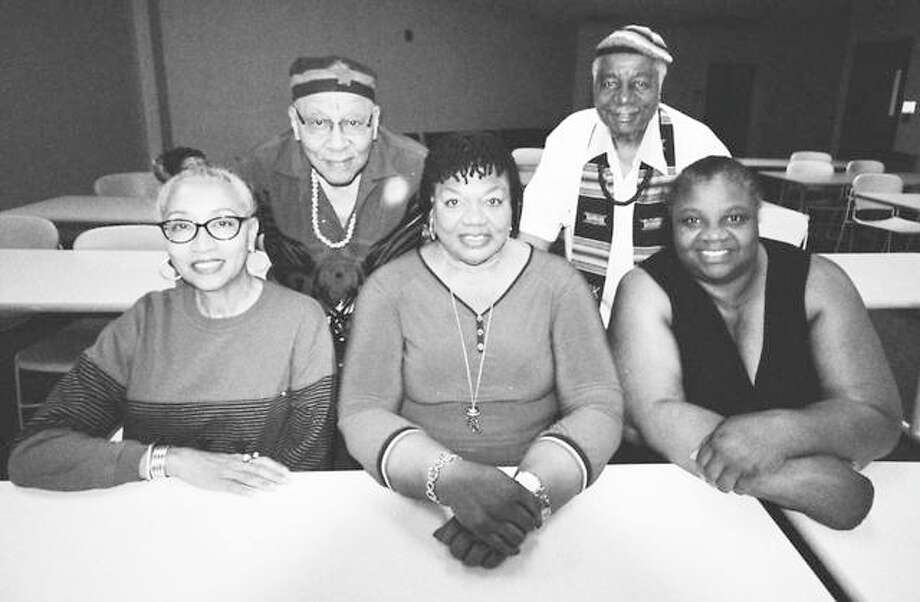 "Oft-published poets of the Eugene B. Redmond Writers Club, seated left to right, Charlois Lumpkin, Darlene Roy, Jaye P. Willis, and, standing left to right, Roscoe ""Ros"" Crenshaw and Eugene B. Redmond. Photo: For The Telegraph"