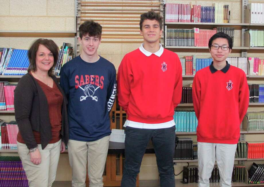 Manistee Catholic Central has three foreign exchange students attending their school this year under the Educational Cultural Exchange Program (ECEP). Shown (left to right ) are ECEP coordinator Cathy French, Jaime Alaman from Spain, Finn Mehring from Germany and Toan (Brian) Bui from Vietnam. (Ken Grabowski/News Advocate)