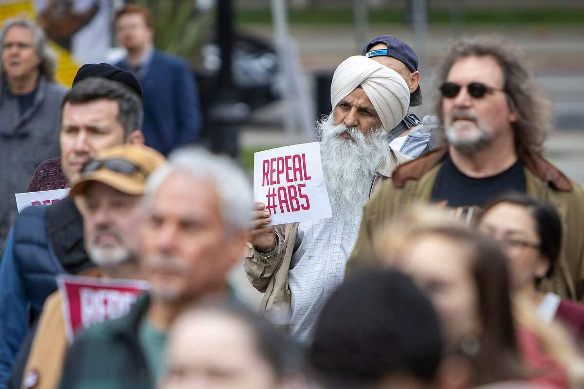 Truck driver Amrik Singh from Antelope, stands with a group of independent freelancers during the repeal AB5 rally at the California State Capitol on Tuesday 28 January 2020 in Sacramento, CA.