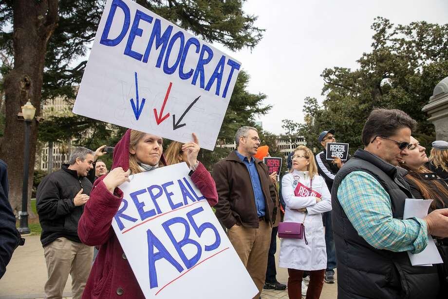 Andrea Vee of Redlands (San Bernardino County) calls for the repeal of AB5 at the January rally. Photo: Peter DaSilva / Special To The Chronicle