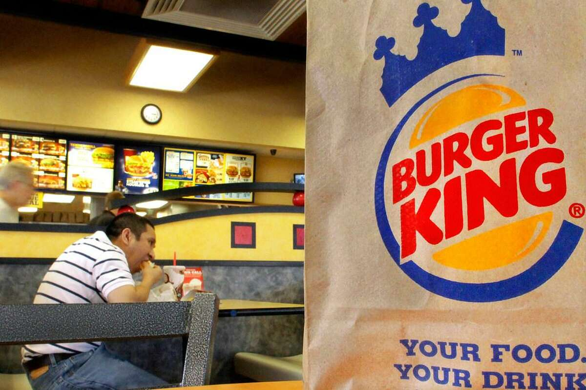 In this Aug. 24, 2010 file photo, patrons enjoy a meal at a Burger King in Springfield, Ill.