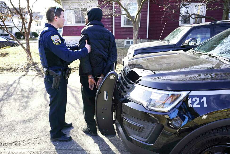 Schenectady Police Officer Pat Irwin arrests a man after the man's girlfriend accused him of assaulting her following a traffic accident on Wednesday, Feb. 5, 2020, in Schenectady, N.Y. (Paul Buckowski/Times Union)