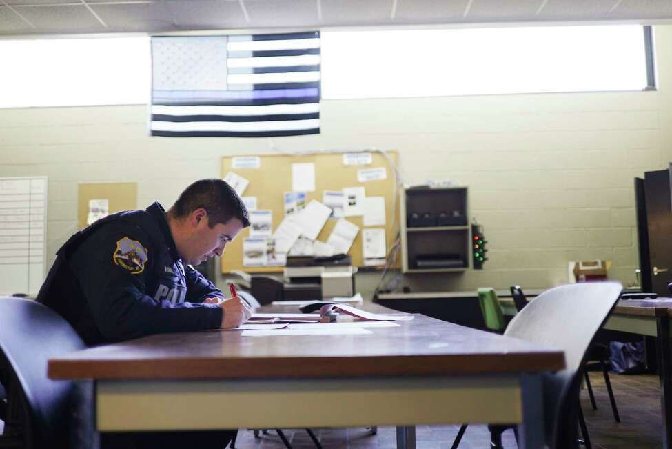 Schenectady Police Officer Pat Irwin fills out paperwork for a domestic abuse call he responded to earlier in the day on Wednesday, Feb. 5, 2020, in Schenectady, N.Y. (Paul Buckowski/Times Union)