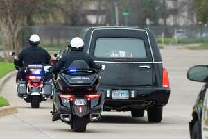 The vehicle carrying Liberty County Sheriff's Deputy Richard Whitten's body is escorted by multiple law enforcement agencies while leaving Harris County Institute of Forensic Sciences Tuesday, Feb. 4, 2020,in Houston. The procession will end at Neal Funeral Home in Cleveland. Whitten, who was wounded in a 2019 shooting in Cleveland, was pronounced dead Monday during a physical therapy session at the Texas Medical Center.