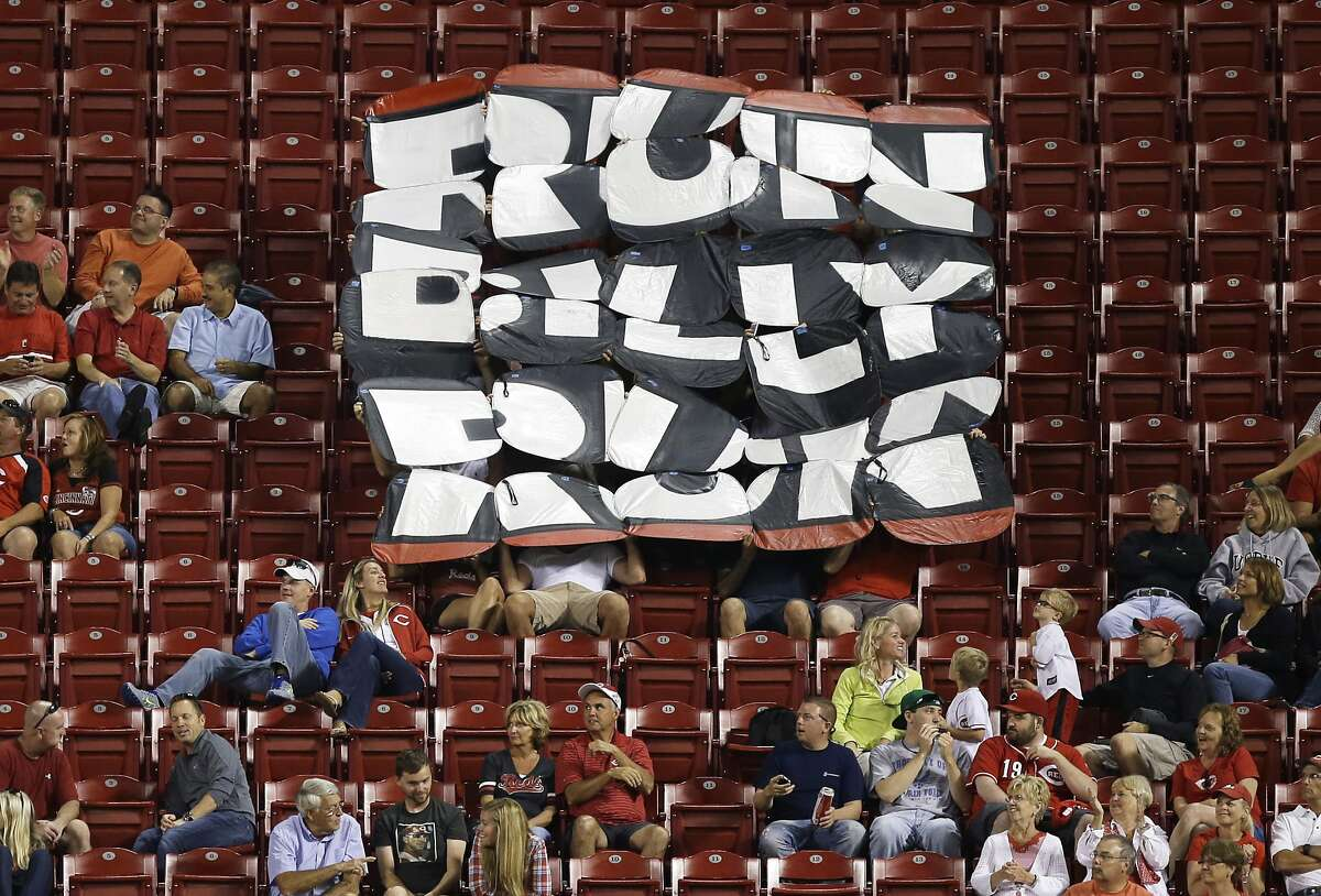 Cincinnati Reds fans display a sign -