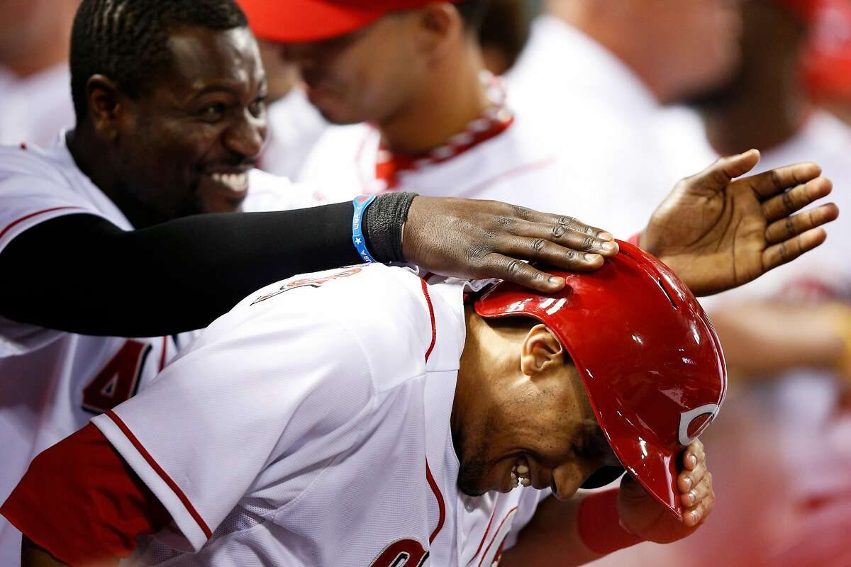 Billy Hamilton #6 of the Cincinnati Reds is mobbed by Brandon Phillips #4 after scoring a run in the seventh inning of the game against the St. Louis Cardinals at Great American Ball Park on September 3, 2013 in Cincinnati, Ohio. The Reds won 1-0. (Photo by Joe Robbins/Getty Images)