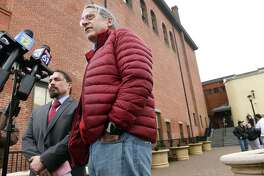 Attorneys Kevin Smith (left) and Norm Pattis speak to the press outside of the Derby Superior Courthouse in Derby, Connecticut, on Feb. 7 after a bond hearing for Jose Morales following charges of murder and tampering with physical evidence for the homicide of Christine Holloway.