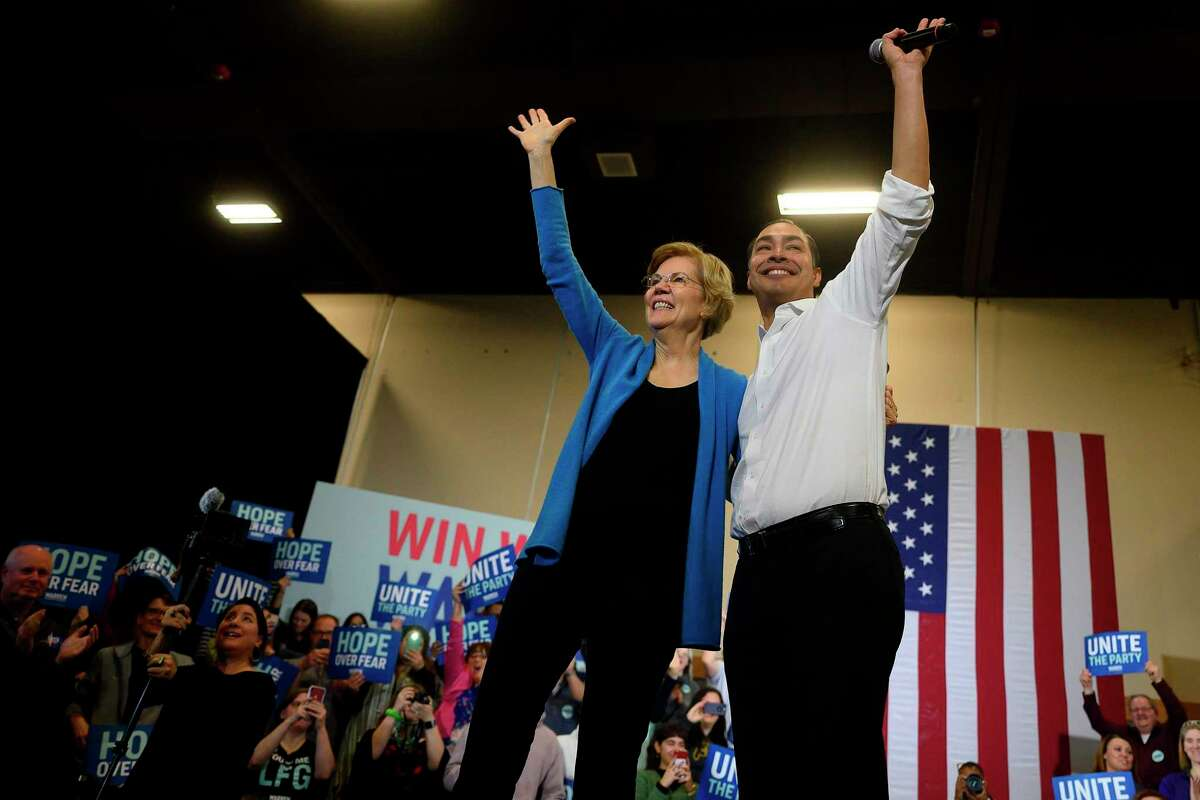 Democratic presidential candidate Massachusetts Senator Elizabeth Warren and former Housing and Urban Development Secretary Julian Castro wave to supporters at a town hall in Davenport, IA, on February 1, 2020. (Photo by JIM WATSON / AFP) (Photo by JIM WATSON/AFP via Getty Images)