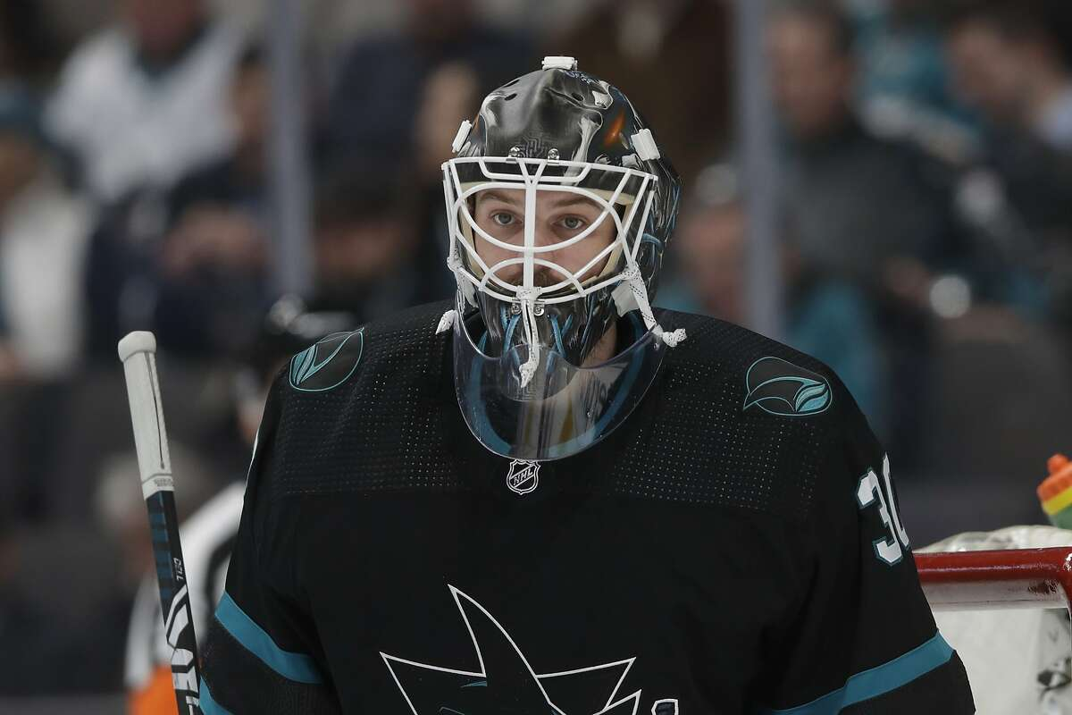 San Jose Sharks goaltender Aaron Dell (30) against the Columbus Blue Jackets during an NHL hockey game in San Jose, Calif., Thursday, Jan. 9, 2020. (AP Photo/Jeff Chiu)