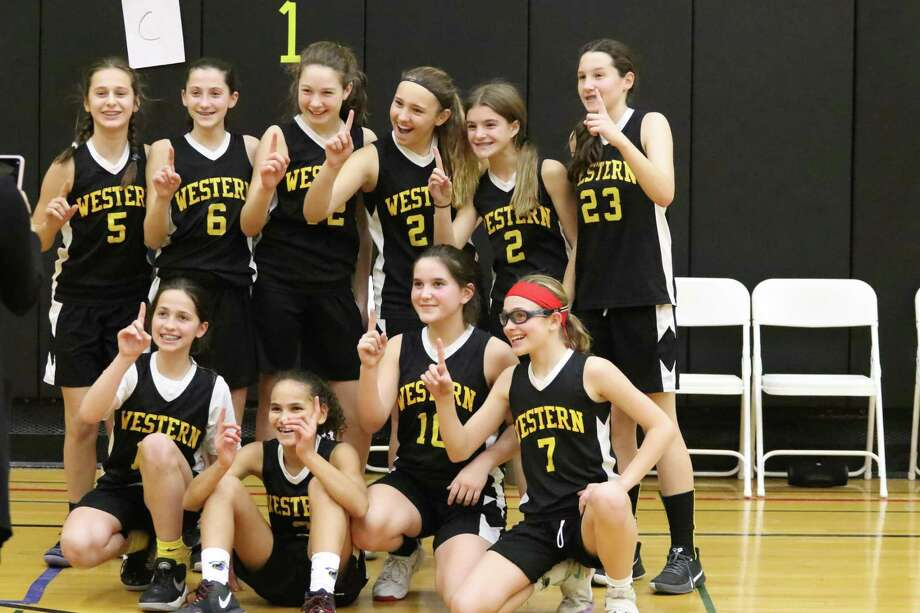 Western Middle School's girls basketball team won the Greenwich Middle School Championships, recently. Photo: Daniel Utzinger / Contributed Photo