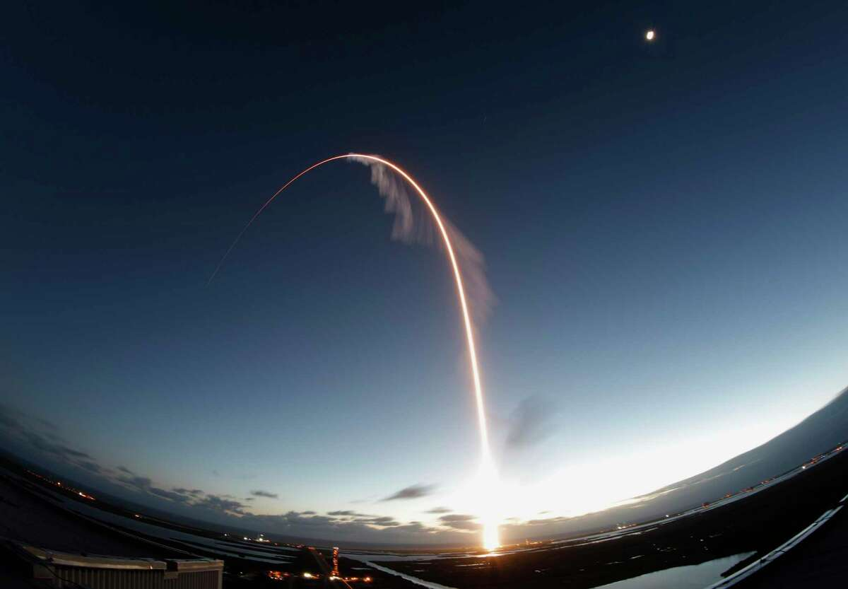 In this long exposure photo, the United Launch Alliance Atlas V rocket carrying the Boeing Starliner crew capsule lifts off on an orbital flight test to the International Space Station from Space Launch Complex 41 at Cape Canaveral Air Force station, Friday, Dec. 20, 2019, in Cape Canaveral, Fla.