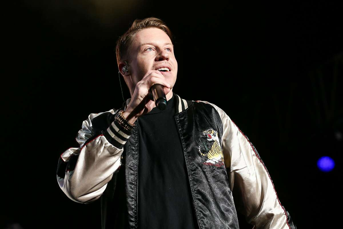 """FILE - In this Dec. 4, 2015 file photo, Macklemore performs on stage at Power 106's Cali Christmas 2015 in Inglewood, Calif. Macklemore explores racism and hip-hop in a new song called """"White Privilege II,"""" rapping about a white person's position in society with black people fighting injustice. (Photo by John Salangsang/Invision/AP, File)"""