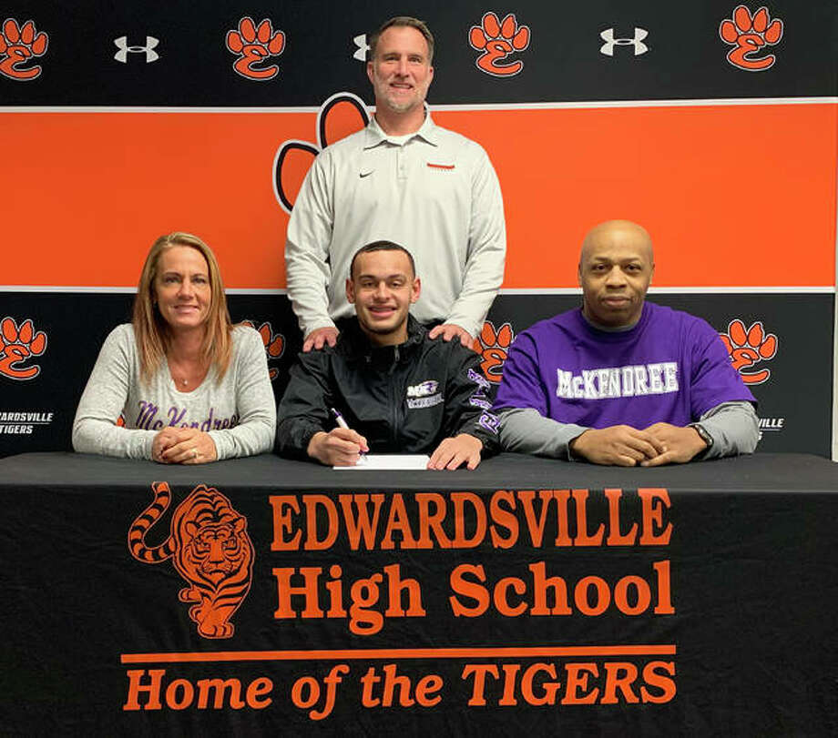 Edwardsville senior Ethan Young will continue his football career at McKendree University. He is joined in the picture by his family and EHS coach Matt Martin. Photo: Matt Kamp|The Intelligencer