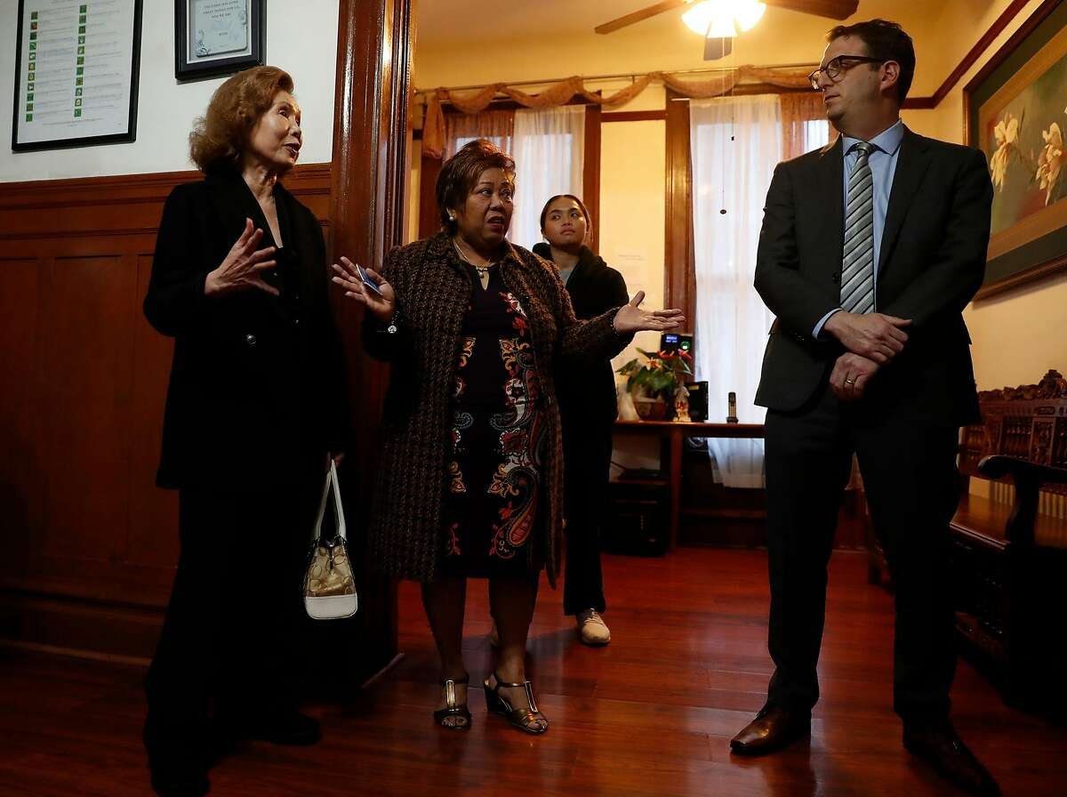 Parkview Inn owner Dellie Punla and 6Beds' Dories Paniza speak with SF District 5 Supervisor Dean Preston at Parkview Inn Board & Care facility in San Francisco, Calif., on Tuesday, January 21, 2020.