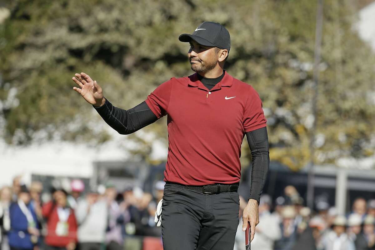 Jason Day waves to spectators after making a birdie putt on No. 18 during the second round of the AT&T Pebble Beach Pro-Am in February. Fans will not be allowed in 2021, tournament officials announced Friday.