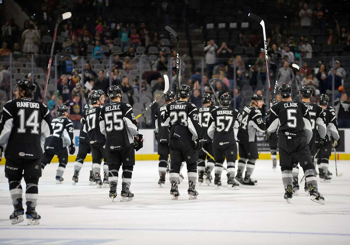 San Antonio Rampage players raise their sticks to salute the audience after an AHL hockey game against the Cleveland Monsters, Sunday, March 12, 2017, in San Antonio. On Monday, the AHL announced it has canceled the rest of the season.