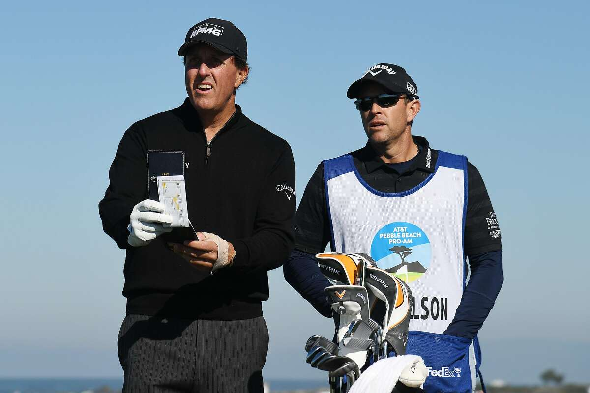 PEBBLE BEACH, CALIFORNIA - FEBRUARY 07: Phil Mickelson of the United States talks with his caddie, Tim Mickelson, before playing his shot from the 13th tee during the second round of the AT&T Pebble Beach Pro-Am at Monterey Peninsula Country Club on February 07, 2020 in Pebble Beach, California. (Photo by Harry How/Getty Images)