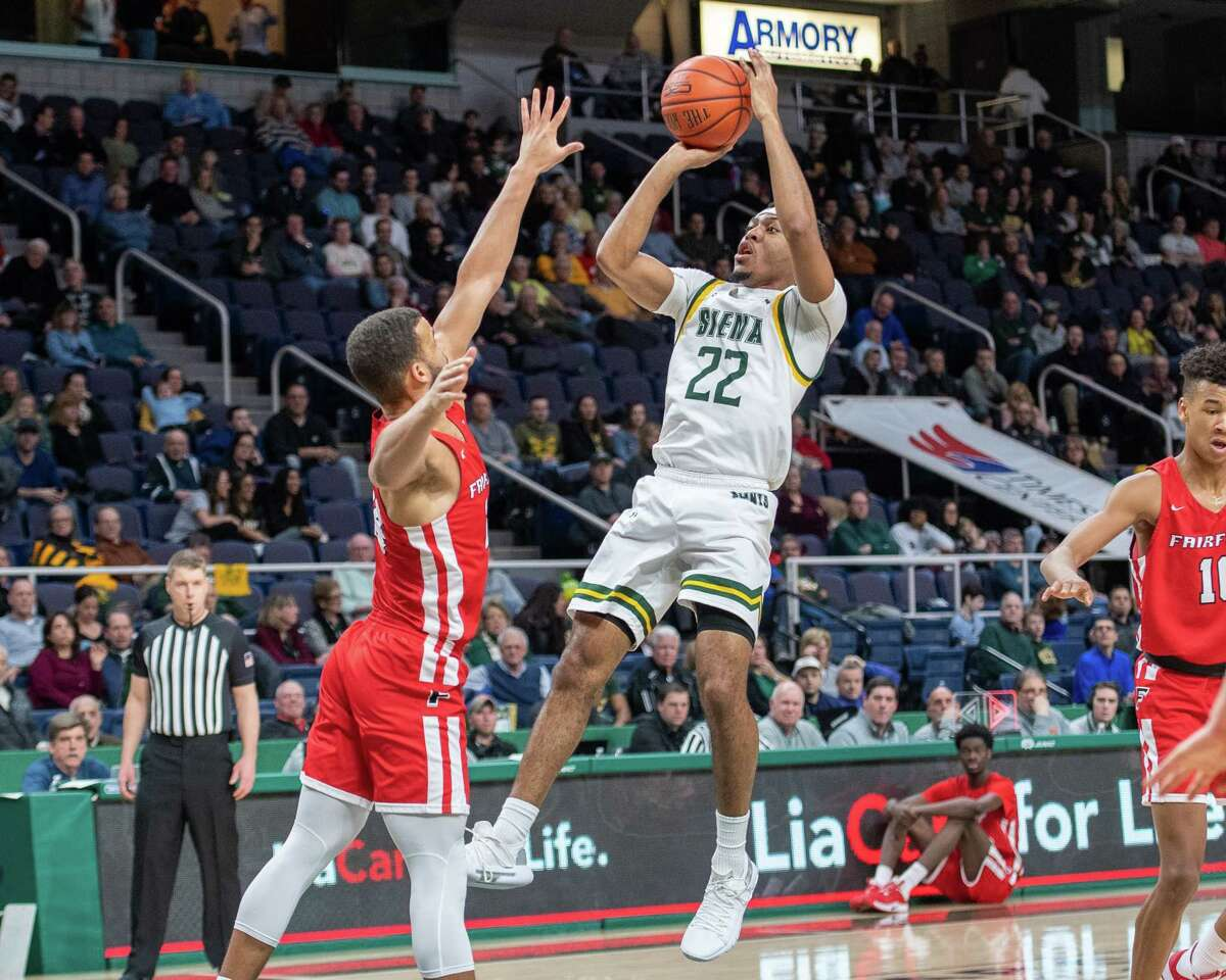Siena College sophomore Jalen Pickett takes a jumper over Fairfield University junior Jesus Cruz during a Metro Atlantic Athletic Conference game at the Times Union Center in Albany NY on Friday, Feb. 7, 2019 (Jim Franco/Special to the Times Union.)
