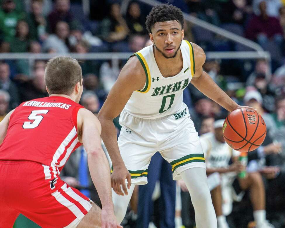 Siena College sophomore Donald Carey makes a move against Fairfield University senior Aidas Kvaliauskas during a Metro Atlantic Athletic Conference game at the Times Union Center in Albany NY on Friday, Feb. 7, 2019 (Jim Franco/Special to the Times Union.)