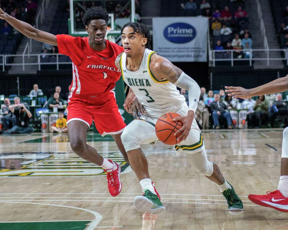 Siena College junior Manny Camper drives to the basket in front of Fairfield University freshman Chris Maidoh during a Metro Atlantic Athletic Conference game at the Times Union Center in Albany NY on Friday, Feb. 7, 2019 (Jim Franco/Special to the Times Union.)