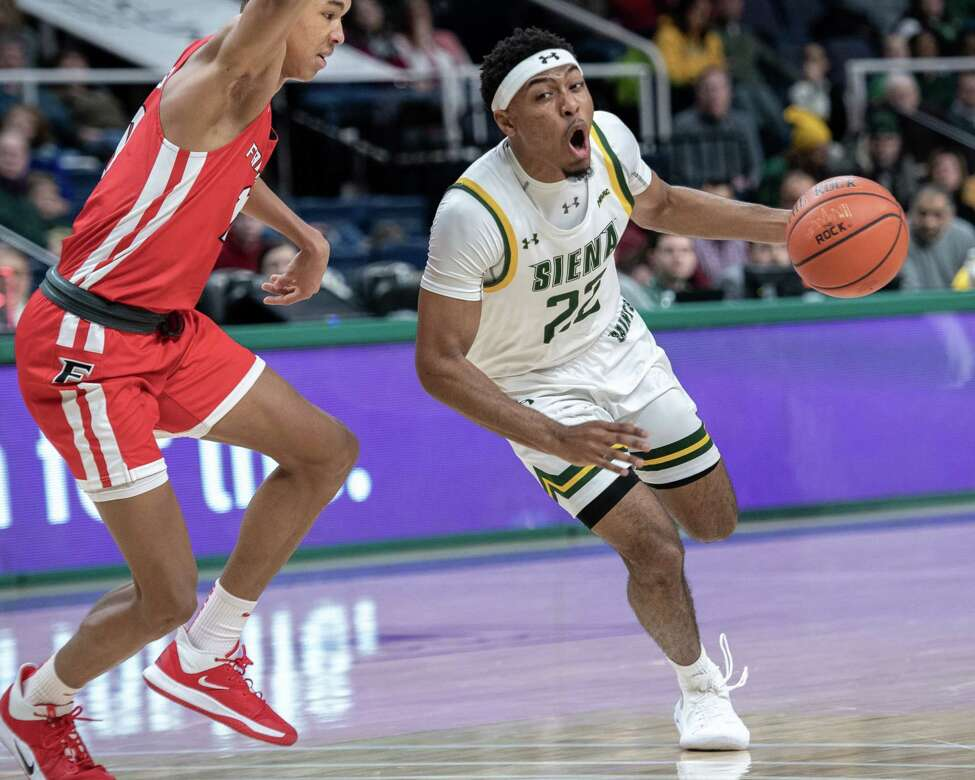 Siena College sophomore Jalen Pickett drives by Fairfield University freshman Allan Jeanne-Rose during a Metro Atlantic Athletic Conference game at the Times Union Center in Albany NY on Friday, Feb. 7, 2019 (Jim Franco/Special to the Times Union.)