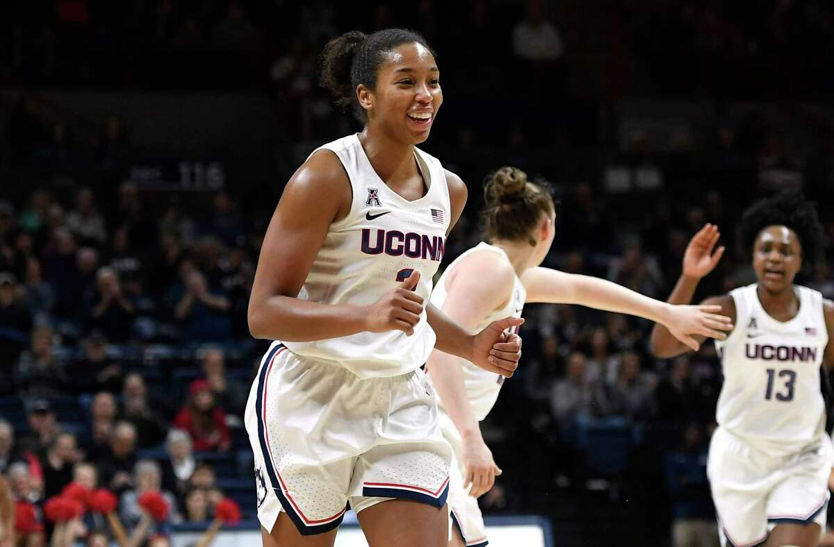 Connecticut's Megan Walker smiles in the first half of an NCAA women's basketball game against Memphis on Feb. 7 in Storrs. Walker was taken ninth overall by the New York Liberty in the WNBA draft.