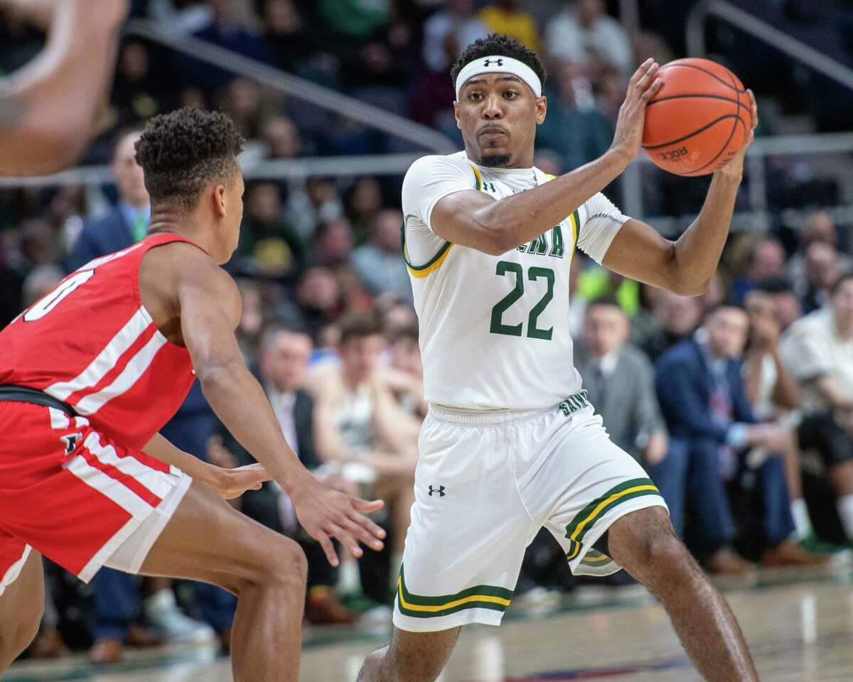 Siena College sophomore Jalen Pickett looks to pass in front of Fairfield University freshman Allan Jeanne-Rose during a Metro Atlantic Athletic Conference game at the Times Union Center in Albany NY on Friday, Feb. 7, 2019 (Jim Franco/Special to the Times Union.)
