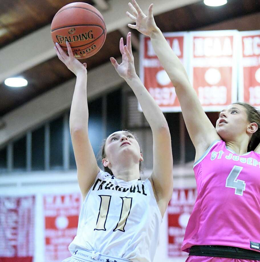 Maeve Hampford goes to the basket for Trumbull in its win against St. Joseph. Photo: David G Whitham / For Hearst Connecticut Media / Copyriqht 2020 David G. Whitham, All rights reserved.