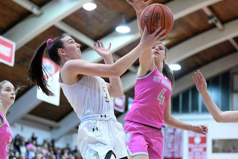 Trumbull High's Emi Roberto puts up two against St. Joseph in the first game of the Playing for a Cure doubleheader at Fairfield University's Alumni Hall, Friday, Feb. 7, 2020. Photo: David G. Whitham / For Hearst Connecticut Media / Stamford Advocate Freelance