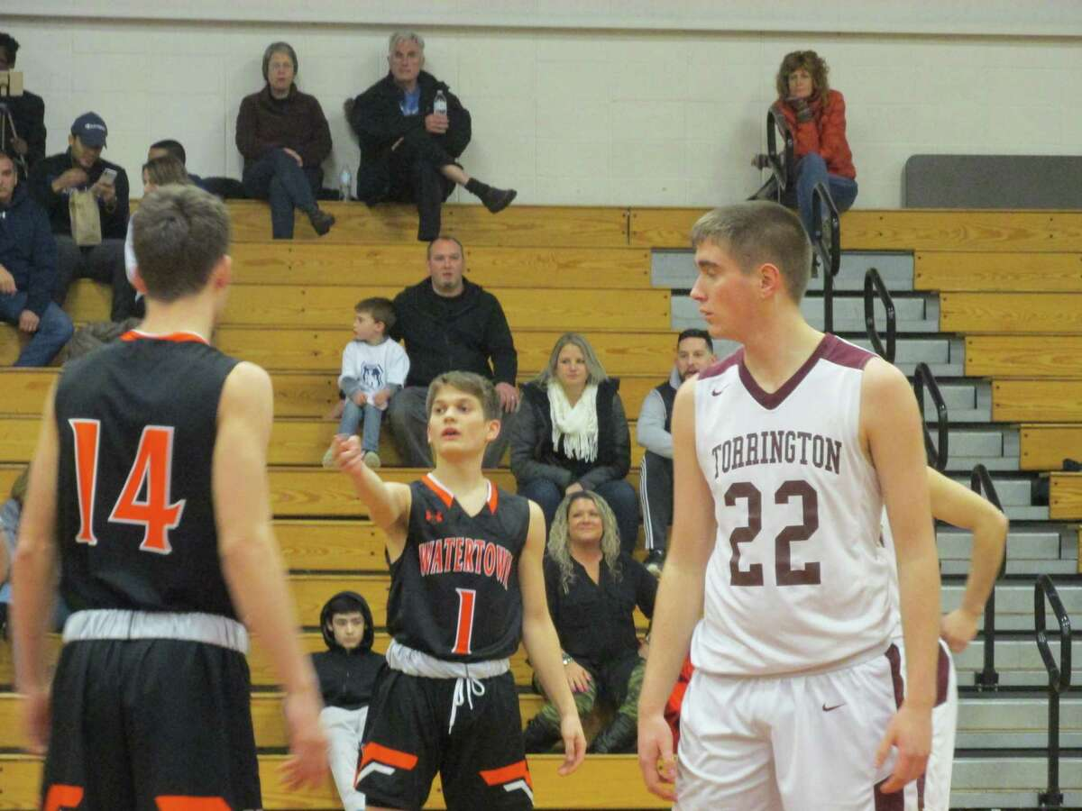 Torrington center Ben Smith (22) had his best game of the season with 10 points and five blocks in a win over Watertown at Torrington High School on Friday, Feb. 7, 2020, keeping the Red Raider hopes alive for their Division II state tournament qualification.