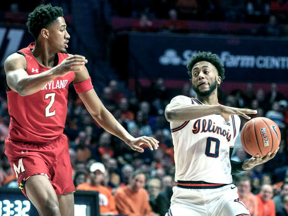 Alan Griffin of Illinois (0) looks to pass the ball as Maryland's Aaron Wiggins (2) defends during Friday night's Big Ten game in Champaign. Photo: AP Photo
