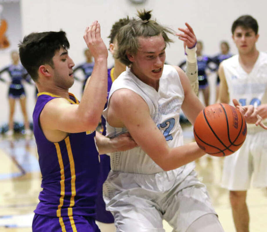 Jersey's Tucker Shalley, right, loses control of the basketball after being fouled on a drive through the lane on CM's Noah Turbyfiill on Friday night at Havens Gym in Jerseyville. Photo: Greg Shashack | The Telegraph
