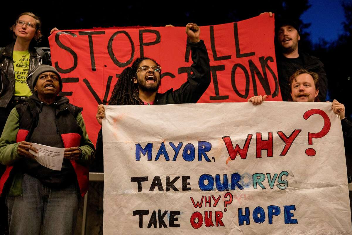 Demonstrators with the group protest outside of Oakland Mayor Libby Schaaf's State of the City address at the Oakland Museum in Oakland, Calif. Friday, February 7, 2020.