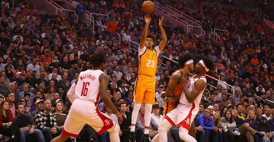 PHOENIX, ARIZONA - FEBRUARY 07: Cameron Johnson #23 of the Phoenix Suns attempts a three point shot over Ben McLemore #16 of the Houston Rockets during the second half of the NBA game at Talking Stick Resort Arena on February 07, 2020 in Phoenix, Arizona. NOTE TO USER: User expressly acknowledges and agrees that, by downloading and or using this photograph, user is consenting to the terms and conditions of the Getty Images License Agreement. Mandatory Copyright Notice: Copyright 2020 NBAE. (Photo by Christian Petersen/Getty Images) Photo: Christian Petersen/Getty Images