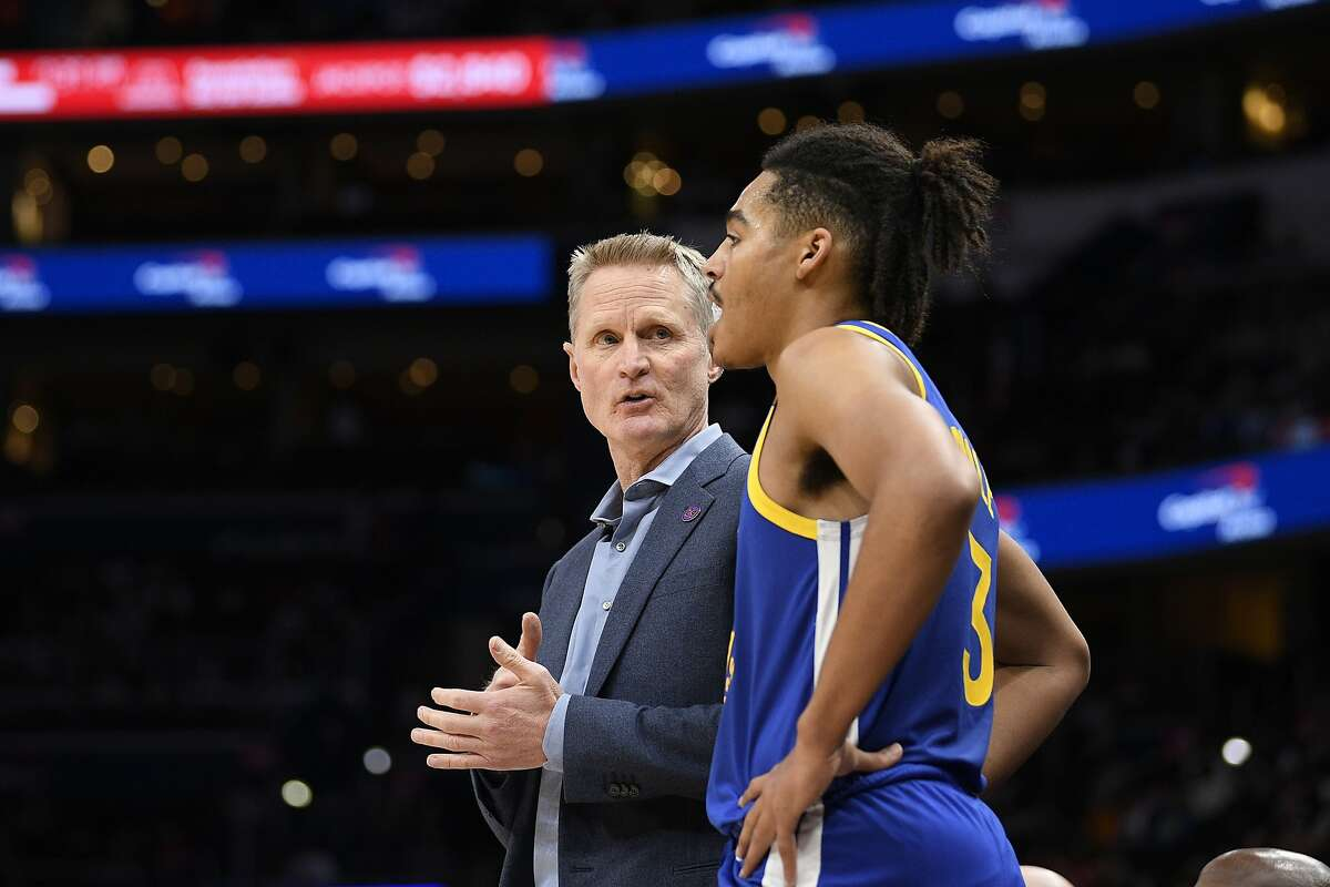 Golden State Warriors head coach Steve Kerr, left, talks with guard Jordan Poole, right, during the first half of an NBA basketball game against the Washington Wizards, Monday, Feb. 3, 2020, in Washington. (AP Photo/Nick Wass)