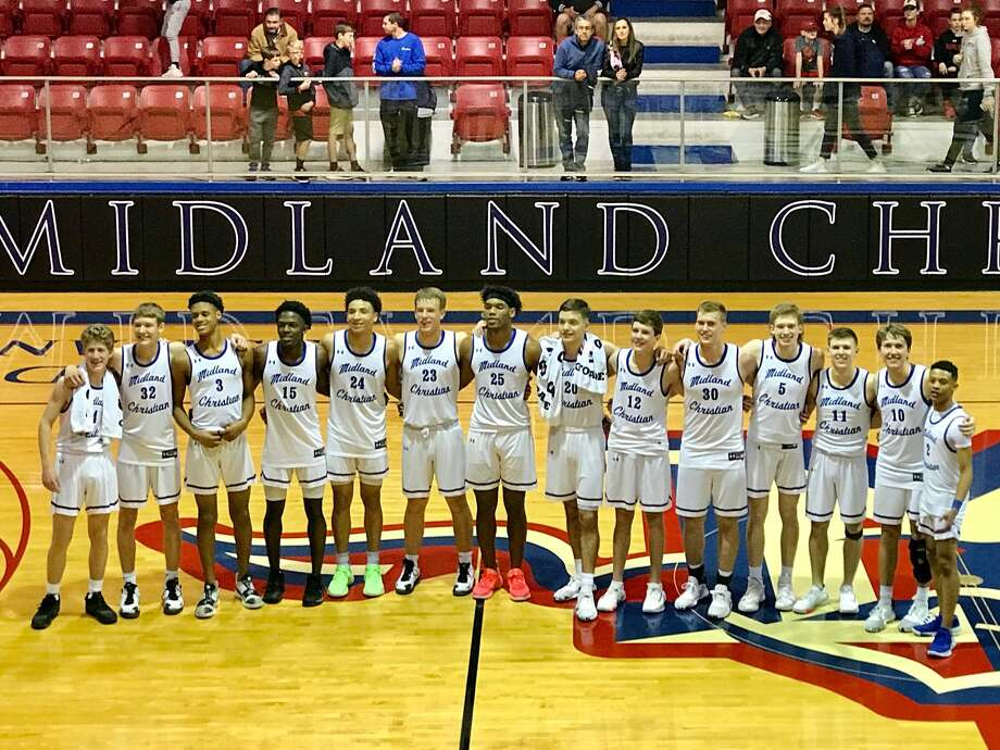 The Midland Christian boys basketball team poses for a team picture after beating Argyle Liberty Christian 85-39 Friday to finish TAPPS 1-6A with an undefeated record. Photo: Courtesy Photo