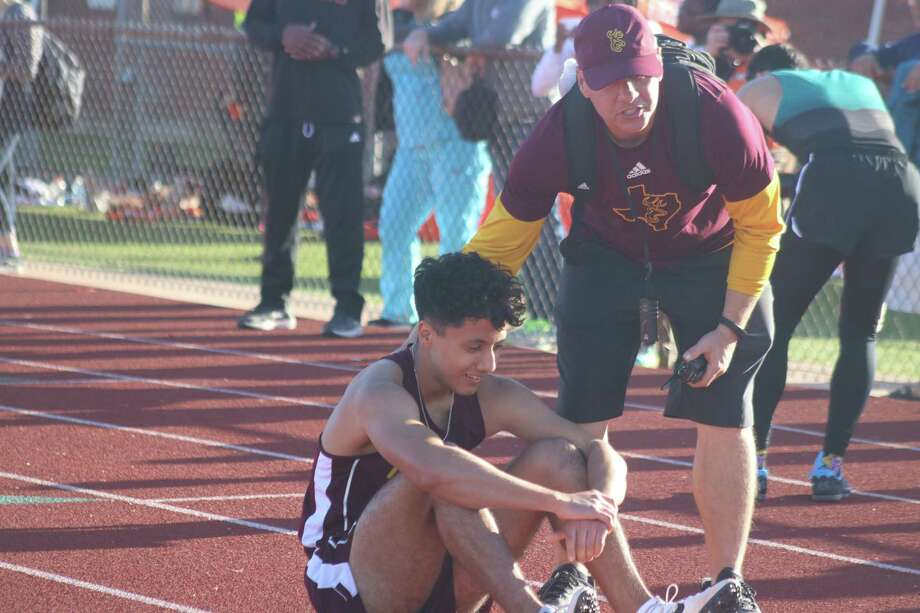 Deer Park coach P.J. Graham congratulates Jesse Gonzalez after he won the 300-meter hurdles Friday afternoon with the time of 41.78 seconds. Photo: Robert Avery