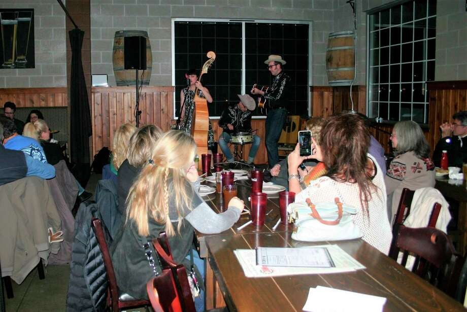 The crowd at Cranker's enjoyed the rockabilly sounds of Delilah DeWylde on Friday night. The show was part of the Festival of The Arts going on all month. (Pioneer photo/Cathie Crew)