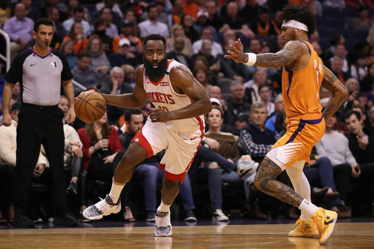 PHOENIX, ARIZONA - FEBRUARY 07: James Harden #13 of the Houston Rockets handles the ball against Kelly Oubre Jr. #3 of the Phoenix Suns during the first half of the NBA game at Talking Stick Resort Arena on February 07, 2020 in Phoenix, Arizona. NOTE TO USER: User expressly acknowledges and agrees that, by downloading and or using this photograph, user is consenting to the terms and conditions of the Getty Images License Agreement. Mandatory Copyright Notice: Copyright 2020 NBAE. (Photo by Christian Petersen/Getty Images)